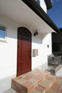 コーヨーテック 漆喰 かわいい家 アール玄関ドア